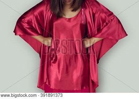Good Night. Women Wearing Red Nightgown & Long Sleeve Satin Robe With Floral Lace In The Bedroom, A