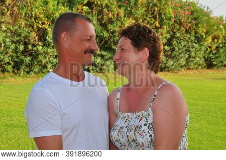 Married Couple, Male, Female. Smile, Joy, Green Background Vacation Vacation By The Sea