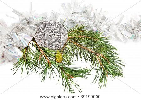 Green Conifer Branch With Silver Ball And Tinsel