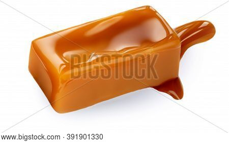 Soft Caramel Isolated On A White Background. Salted Melted Toffee Candy With Caramel Sauce, Top View