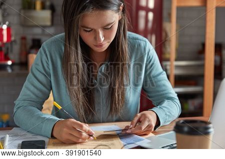 Cropped Image Of Attractive Woman Rewrites Card Number, Checks Her Banking Account, Works On Outlay