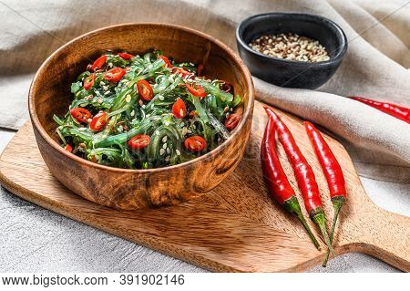Healthy Seaweed Chuka Salad With Greens And Red Chili Pepper. Gray Background. Top View