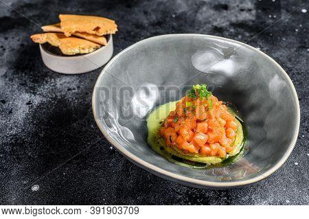 Fresh Tartar With Salmon, Avocado. Black Background. Top View.