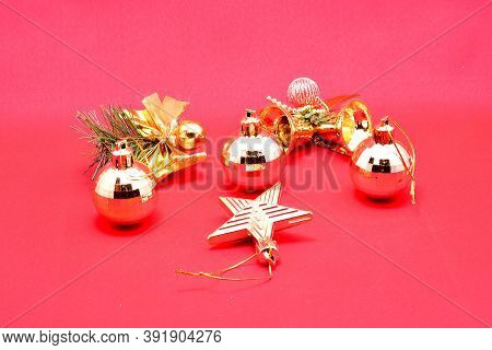 Christmas Toys, Set Of Gold Ornaments, Ball, Star, Bells, On A Red Background