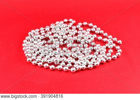 Christmas Tree Decorations, Beads, Garlands, On A Red Background, Decoration Design