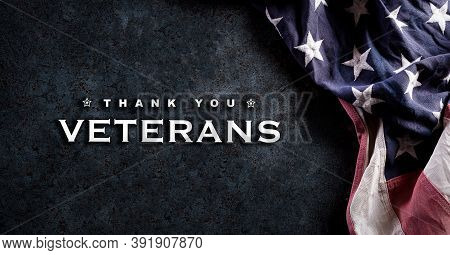 Happy Veterans Day Concept. Vintage American Flags Against Dark Stone  Background. November 11. Day