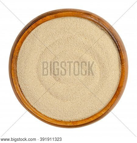 Dry Yeast In A Wooden Bowl. Small Oblong Granules Of Active Bakers Yeast, Commonly Used In Baking Br