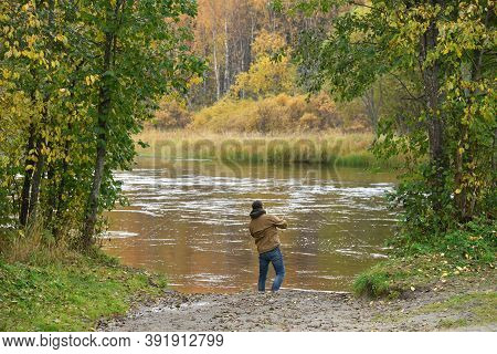 Man Is Fishing On A River On An Autumn Day. Active Lifestyle, Outdoor Recreation. Karelia, Russia