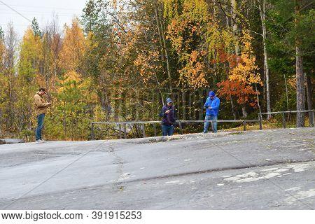 Zalavruga, Belomorsk, Karelia, Russia - October 5, 2020:.  Tourists Visit The   White Sea Petroglyph