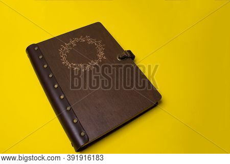 Family Photo Book With Embossing. Brown Photo Book With Dark Wood Cover. Wedding Photo Album.