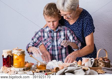 Happy Senior Mature Woman, Grandmother And Young Boy, Grandson Cooking, Kneading Dough, Baking Pie,