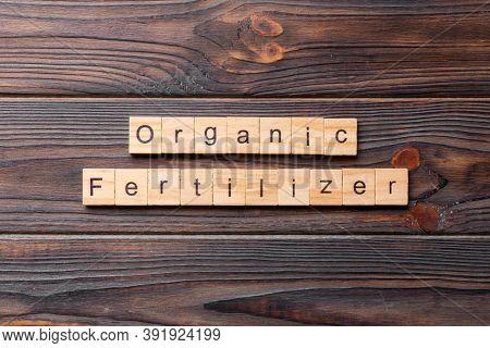 Organic Fertilizer Word Written On Wood Block. Organic Fertilizer Text On Cement Table For Your Desi