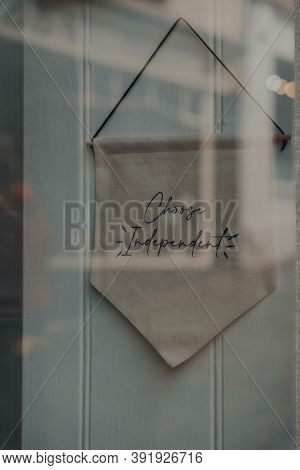 View Through The Window Of Chose Independent Sign Inside A Shop In Frome, Somerset, Uk.