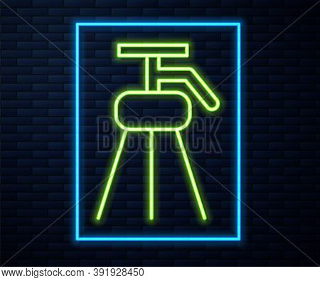 Glowing Neon Line Tripod Icon Isolated On Brick Wall Background. Vector Illustration