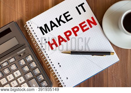 Make It Happen Written In A White Notepad Near A Calculator And A Cup Of Coffee On A Dark Wooden Bac