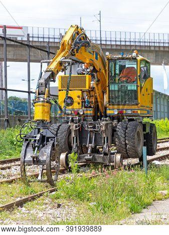 Excavator Machine At Railroad Tracks Maintenance Work