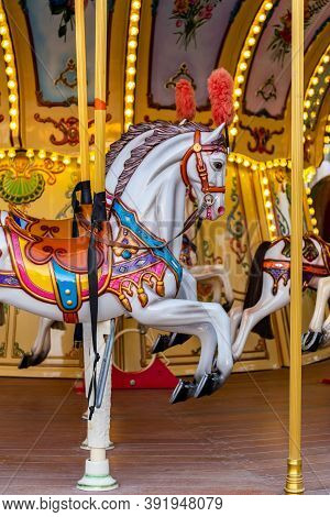 Colorful Carousel Horse On A Vintage Illuminated Roundabout Carousel (merry Go Round) In A Park In D