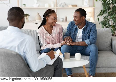 Reconciliation Concept. Happy Young Black Couple Holding Hands On Reconciling Session At Marital The