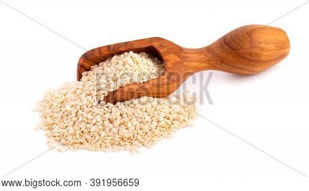 Sesame Seeds In Wooden Scoop, Isolated On White Background. Organic Dry Sesame Seeds.