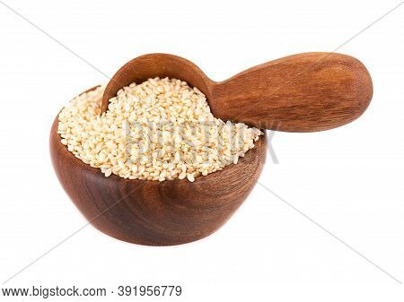 Sesame Seeds In Wooden Bowl And Spoon, Isolated On White Background. Organic Dry Sesame Seeds.