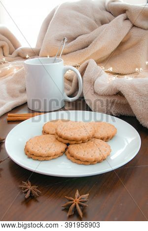 Living Room Details In Winter. Close-up Of A White Mug With An Infusion On A Wooden Table With Anise