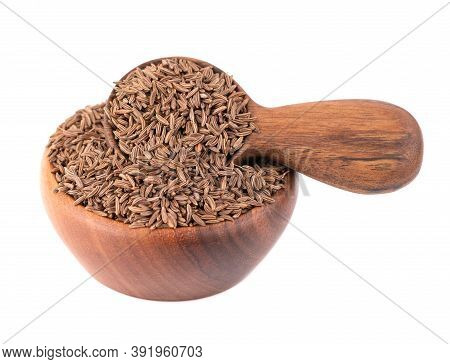 Cumin Seeds In Wooden Bowl And Spoon, Isolated On White Background. Cumin Seeds Or Caraway.