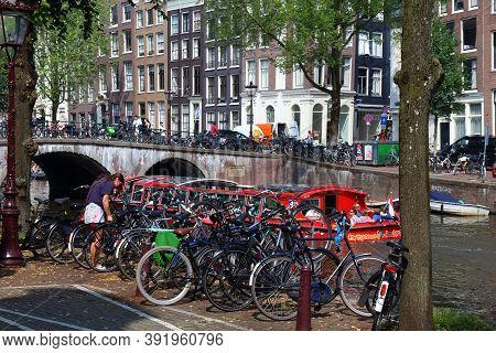 Amsterdam, Netherlands - July 7, 2017: People Ride A City Tour Boat On Keizersgracht Canal In Amster