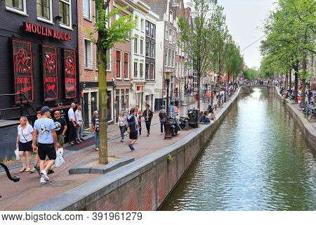 Amsterdam, Netherlands - July 8, 2017: People Visit Red Light District In Amsterdam, Netherlands. Am