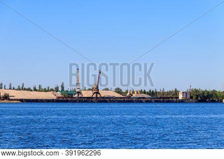 Hoisting Cranes At Cargo Port On The Dnieper River In Kremenchug, Ukraine