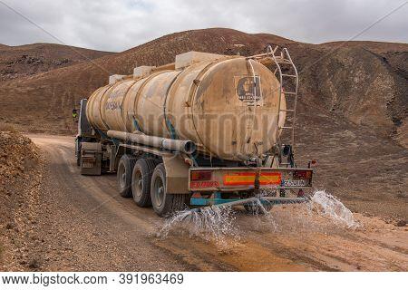 Corralejo, Fuerteventura, Spain: 2020 September 02:  Tanker Truck Pouring Water On The Fuerteventura