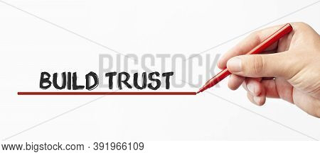 Hand Writing Build Trust With Red Marker. Isolated On White Background. Business, Technology, Intern