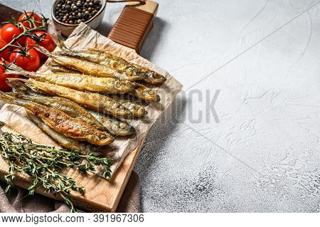 Grilled Smelt Fish. Delicious Appetizer. Gray Background. Top View. Copy Space