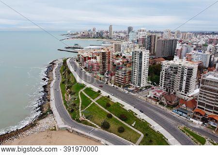 Aerial View From Drone Of Panoramic Cityscape Of Mar Del Plata City. Paseo Davila Road Along Coastli