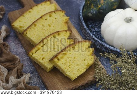 Pumpkin Bread With Thyme And Turmeric On A Board