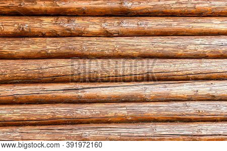 Wooden Logs With Natural Patterns As Background, Wooden Logs Texture. Wall Of Round Wooden Logs