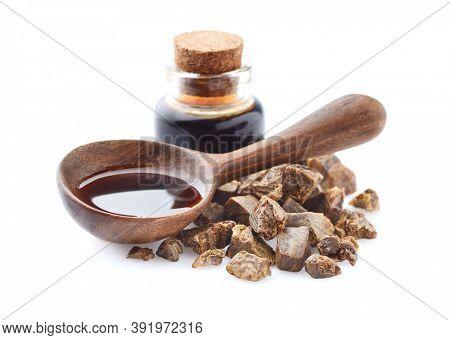 Propolis tincture in wooden spoon . Natural antibiotic