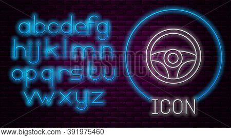 Glowing Neon Line Steering Wheel Icon Isolated On Brick Wall Background. Car Wheel Icon. Neon Light