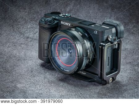 Fort Collins, CO, USA - October 7, 2020: Sony A6400 mirrorless camera with a turret pinhole lens and UV filter to protect sensor from dust - combining modern technology with old photography technique.