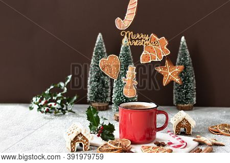 Christmas Cappuccino And Gingerbread Cookies Levitating Above Red Mug.