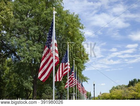 American Flags In A Display Honoring Military Veterans Along A Street In A Small Town