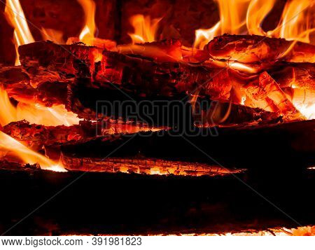 Red Flame Of Fire In A Wood Stove.