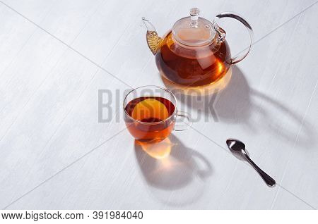 Sunny Tradition Teatime With Black Tea In Transparent Teapot With Cup In Bright Cozy Orange Sun Beam