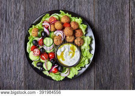 Mediterranean Platter Of Falafels, Tomatoes, Cucumber, Red Onion, Black Olives, On The Fresh Salad L