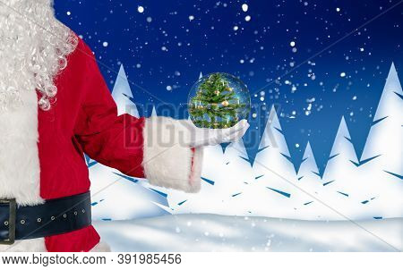 Santa Holds A Glass Ball With A Christmas Motif In His Hand Against Wintery Background