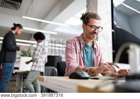 Programmer Working And Developing Software In Office