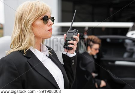 Female Bodyguard. Celebbrity Bodyguard And Vip Protection Services. Black Suit And Walkie Talkie. Se