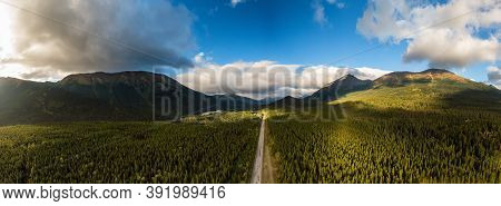 Panoramoic View Of Scenic Road Surrounded By Forest Valley, Mountains And Industry At Sunrise In Can