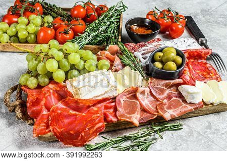 Antipasto Platter Cold Meat With Grapes, Prosciutto, Slices Ham, Beef Jerky, Chorizo Salami, Fuet, C