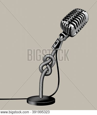 Retro microphone tied with a knot. Vintage engraving stylized drawing