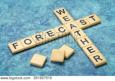 weather forecast crossword in ivory letter tiles against textured handmade paper, application of science and technology to predict the conditions of the atmosphere